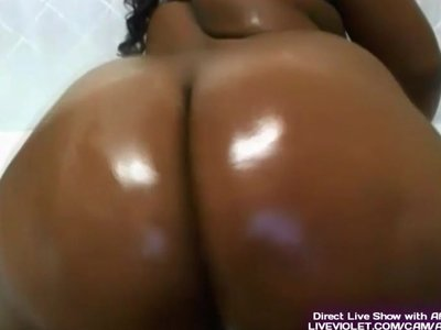 Oiled african booty masturbates her fat pussy