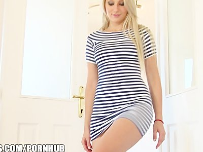 Playful blonde with a SEXY body strips and fingers herself